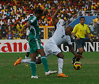 Photo: Steve Bond/Richard Lane Photography.<br />Ghana v Nigeria. Africa Cup of Nations. 03/02/2008. John Obi Mikel (L) gives Junior Agogo (R) a tap