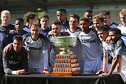 Derby County defender Richard Keogh (6) and the Derby players are presented with the Bass Charity Vase during the Pre-Season Friendly match between Burton Albion and Derby County at the Pirelli Stadium, Burton upon Trent, England on 20 July 2019.