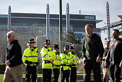 "© Licensed to London News Pictures . 23/02/2019. Salford, UK. Police in front of barriers blocking off access to the BBC at Media City . Supporters of Tommy Robinson (real name Stephen Yaxley-Lennon ) and anti-fascists opposed to the former EDL leader and his followers , gather near to the BBC at Media City to protest , as Yaxley-Lennon hosts a rally showing a home-made documentary , "" Panodrama "" , described as an exposé of the BBC's Panorama documentary series . A BBC Panorama documentary is due to feature an investigation in to Yaxley-Lennon in the near future . Photo credit: Joel Goodman/LNP"