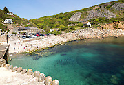 People enjoying summer sunshine Lamorna Cove, Cornwall, England, UK