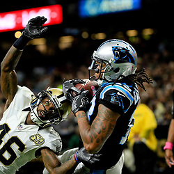 Oct 16, 2016; New Orleans, LA, USA; Carolina Panthers wide receiver Kelvin Benjamin (13) catches the ball but is ruled out of bounds as New Orleans Saints cornerback Ken Crawley (46) defends on the play during the second quarter of a game at the Mercedes-Benz Superdome. Mandatory Credit: Derick E. Hingle-USA TODAY Sports
