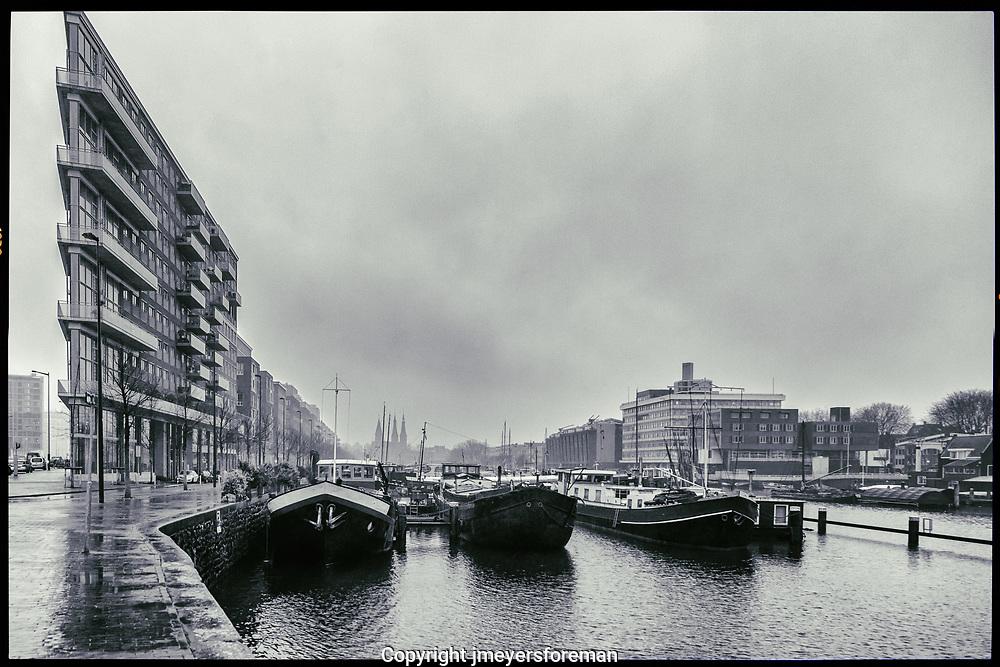 Westerdok Harbour, Amsterdam Netherlands under the grey winter skies