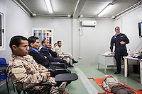 "VALLETTA, MALTA - 8 FEBRUARY 2017: Officials and petty officials of the Libyan Navy Coastguard and Libyan Navy attend a first-aid course held by an Italian Navy medic instructor in a container in the hangar of the San Giorgio, an amphibious transport dock of the Italian Navy, in Valetta, Malta, on Febuary 8th 2017.<br /> <br /> As a consequence of the April 2015 Libya migrant shipwrecks, the EU launched a military operation known as European Union Naval Force Mediterranean (EUNAVFOR Med), also known as Operation Sophia, with the aim of neutralising established refugee smuggling routes in the Mediterranean. The aim of this new operation launched by Europe is to undertake systematic efforts to identify, capture and dispose of vessels as well as enabling assets used or suspected of being used by migrant smugglers or traffickers. On 20 June 2016, the Council of the European Union extended Operation Sophia's mandate reinforcing it by supporting the training of the Libyan coastguard.<br /> Thus far, following EUNAVFOR MED operation Sophia's activities, 101 suspected smugglers and traffickers have been apprehended and transferred to the Italian<br /> authorities and 380 boats were removed from the criminal organizations' availability. The Operation has saved 32.081 migrants, among whom 1888 children.<br /> <br /> On February 2nd 2017 Italian Premier Paolo Gentiloni and Prime Minister of the U.N. backed Libyan government Fayez al-Serraj signed a memorandum of understanding on cooperation to combat illegal migration, human trafficking and contraband and on reinforcing the border between Libya and Italy. The following day, as EU leaders meet in Malta for a summit, European Council President Donald Tusk said after talks with Serraj, that ""it is time to close the (migrant) route from Libya to Italy"" and that ""the EU has shown it is able to close the routes of irregular migration, as it has done in the eastern Mediterranean.""  Tusk said the Central Mediterranean route was ""not sustainable either for"