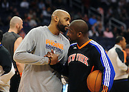 Jan. 7 2011; Phoenix, AZ, USA; Phoenix Suns guard Vince Cartert (left) talks with New York Knicks guard Raymond Felton (right) on the court at the US Airways Center. The Knicks defeated the Suns 121-96. Mandatory Credit: Jennifer Stewart-US PRESSWIRE.