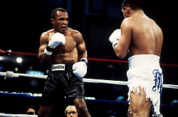 1 Mar 1997:  Sugar Ray Leonard, left, battles Hector Macho Camacho. He lost the fight to Camacho in the fifth round..Mandatory Credit:  Manny Millan/Icon SMI