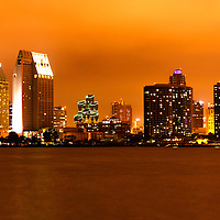 San Diego skyline at night along San Diego Bay. San Diego is a major city in Southern California in the United States. The photo is high resolution and was taken in 2012.