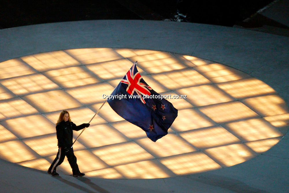 Angela Paul (NZL) carries the flag into the stadium as the athletes are welcomed at the opening ceremony of the Winter Olympics, Salt Lake City, Utah,  USA, 8 February 2002. Photo: PHOTOSPORT<br />