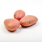 Fresh and organic potatoes on white background