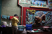 KADEEJEEN, BANGKOK, THAILAND, DECEMBER 2012:.Kian An Keng Shrine, a chinese old temple in Kadeejeen area, Dec 2012..The Kadeejeen neighbourhood comprises six communities  Wat Kalaya, Kudeejeen, Wat Prayurawong, Wat Bupparaam, Kudee Khao and Roang Kraam...Ever since the Thonburi era (in the 17th Century), these historic neighbourhoods have maintained the diverse cultural heritage of three religions and four beliefs (Theravada Buddhism, Mahayana Buddhism, Christianity and Muslim) while coexisting in peaceful harmony...The neighbourhood is still characterised by Bangkok's traditional urbanism which is that of a fine-grained, religious establishment-centred urban structure with close-knit social cohesion. ©Giulio Di Sturco/Reportage by Getty Images.