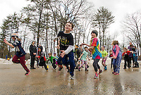 """Meredith Parks and Rec """"day campers"""" enjoyed a variety of parking lot games with the temperatures feeling like spring on Thursday.  (Karen Bobotas/for the Laconia Daily Sun)"""