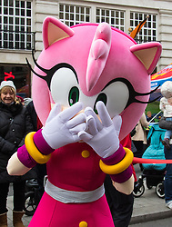 Regent Street, London, Novemeber 28th 2015. Celebrating its 255th birthday world famous toy retailer Hamleys Christmas Toy Parade brings festive fun to London's busy west end. Characters appearing include Barbie and her pink Limo, Elmo & Phoebe, Furchester Hotel, Fireman Sam, Hello Kitty, Ice age Sid and Scrat, Miffy, Peppa Pig, The Gruffalo, Transformer Optimus Prime Truck and others.  //// FOR LICENCING CONTACT: paul@pauldaveycreative.co.uk TEL:+44 (0) 7966 016 296 or +44 (0) 20 8969 6875. ©2015 Paul R Davey. All rights reserved.