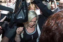 Image ©Licensed to i-Images Picture Agency. 04/07/2014. London, United Kingdom. Bindi Harris leaves court after her father is sentenced to five years and nine months in jail. Southwark Crown Court. Picture by Daniel Leal-Olivas / i-Images