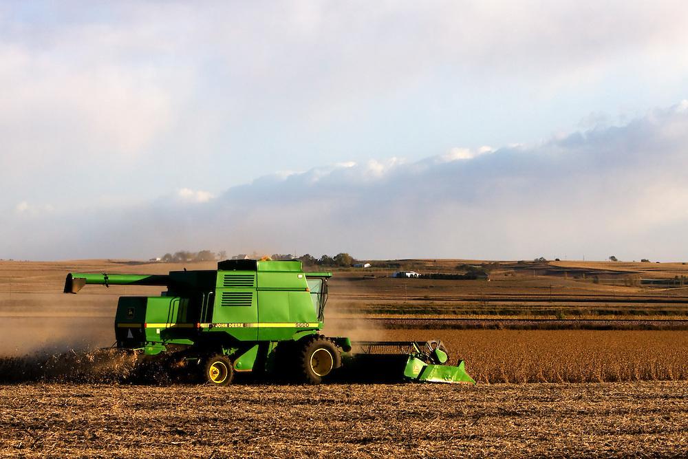 A John Deere Combine Stirs Up Dust On Dry Day In Western Iowa As It