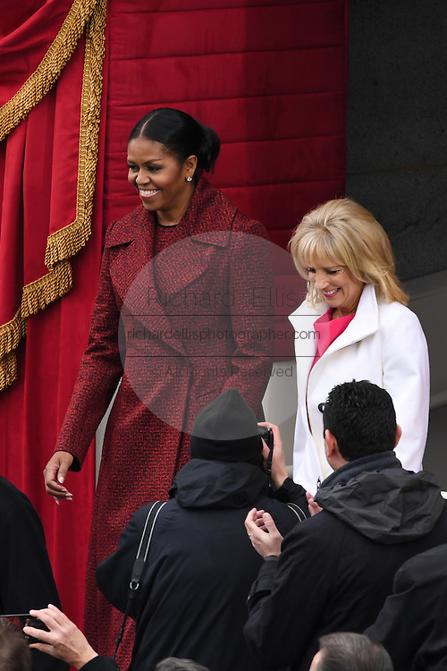 First Lady Michelle Obama and Dr. Jill Biden arrive for the President Inaugural on Capitol Hill January 20, 2017 in Washington, DC. Donald Trump became the 45th President of the United States.