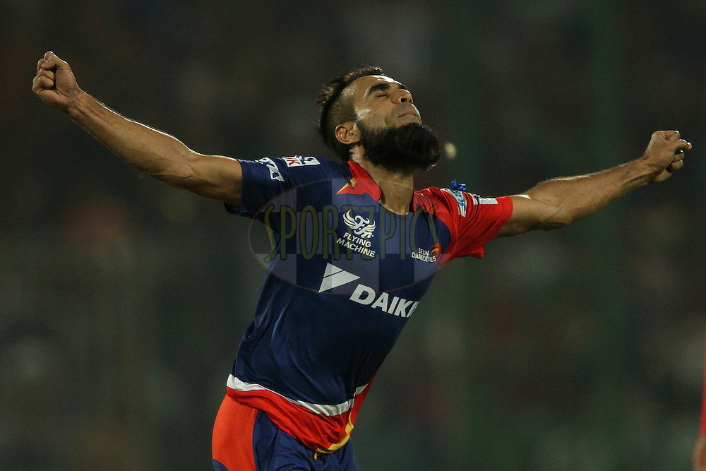 Imran Tahir of the Delhi Daredevils celebrates getting Ambati Rayudu of Mumbai Indians wicket during match 21 of the Pepsi IPL 2015 (Indian Premier League) between The Delhi Daredevils and The Mumbai Indians held at the Ferozeshah Kotla stadium in Delhi, India on the 23rd April 2015.<br /> <br /> Photo by:  Shaun Roy / SPORTZPICS / IPL