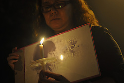 Malaysian ethnic Chinese woman holds a placard during a vigil for the missing Malaysia Airlines passengers in Kuala Lumpur, Malaysia , March 10, 2014. Malaysia Airlines flight MH370 with 239 people on board went missing early 08 March 2014 while on its way to Beijing, China. Malaysia will expand search and rescue operations to locate the missing Malaysia Airlines passenger jet with 239 people on board, as the third day of searching yielded no results, a senior Malaysian aviation official said,  Monday, 10th March 2014. Picture by Mohd FIrdaus / i-Images