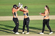 Carla Rudd, Tammy Beaumont, and Amanda-Jade Wellington of Southern Vipers celebrate the wicket of Sophie Luff during the Kia Women's Cricket Super League Final match between Western Storm and Southern Vipers at the 1st Central County Ground, Hove, United Kingdom on 1 September 2019.