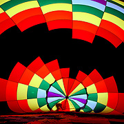 Inside the brightly colored balloon of Dale Ritchie of Canada, as his crew prepares the balloon for launch during The World Hot Air Ballooning Championships. Battle Creek, Michigan, USA. 19th August 2012. Photo Tim Clayton