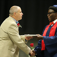 Earvin Carouthers IV recieves his diploma from Nettleton's Principal Jeffrey Credille.