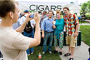 Photographer captures image of new found friends after getting buzz cut. Grand Old Day Street Fair St Paul Minnesota USA
