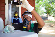 Jovita Masanyika measuring ingredients whilst making some shampoo.<br /> <br /> Jovita set up and now runs a soap making business selling a variety of soaps from shampoo to disinfectant.<br /> <br /> She attended MKUBWA enterprise training run by the Tanzania Gatsby Trust in partnership with The Cherie Blair Foundation for Women.
