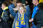 Wimbledon fans celebrate at full time during the EFL Sky Bet League 1 match between Scunthorpe United and AFC Wimbledon at Glanford Park, Scunthorpe, England on 30 March 2019.