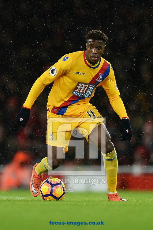Wilfried Zaha of Crystal Palace during the Premier League match between Arsenal and Crystal Palace at the Emirates Stadium, London<br /> Picture by Richard Blaxall/Focus Images Ltd +44 7853 364624<br /> 01/01/2017