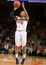Virginia guard Calvin Baker (4) shoots a three point jump shot against Xavier.  The #22 ranked Xavier Musketeers defeated the Virginia Cavaliers 84-70 at the John Paul Jones Arena on the Grounds of the University of Virginia in Charlottesville, VA on January 3, 2009.