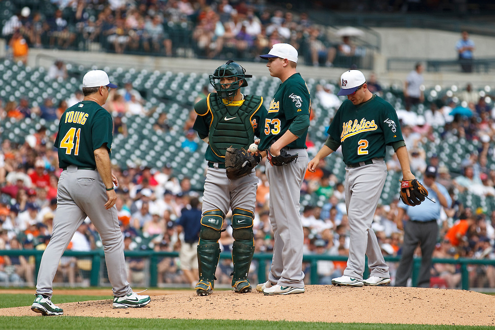 May 31, 2010: Oakland Pitching Coach Curt Young #41, Oakland Athletics' Kurt Suzuki (8), Trevor Cahill (53) and Cliff Pennington (2) during the MLB baseball game between the Oakland Athletics and Detroit Tigers at  Comerica Park in Detroit, Michigan. Oakland defeated Detroit 4-1.