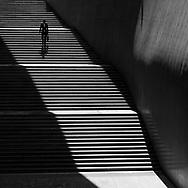 A man walks down a set of stairs in Dongdaemun Design Plaza in Seoul, Korea.