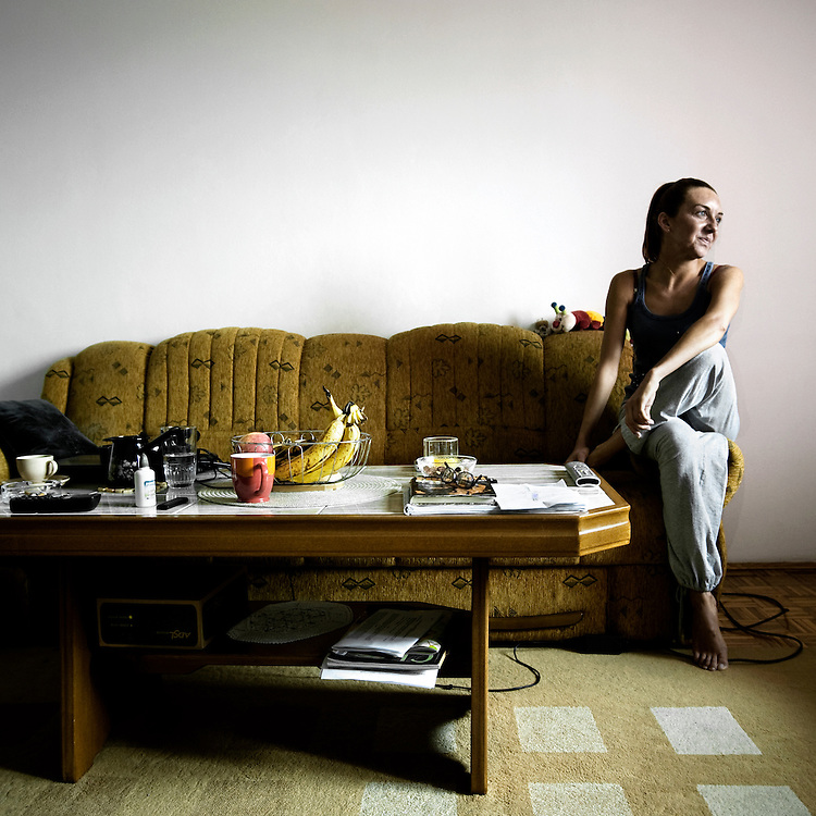 Sarajevo .Pelenda Sahzudina in her living room. Pelenda is a professional dancer, she lives at Mojmilo Olympic village and works in the same neighbourhood at  Sos centre as teacher.
