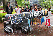 Houston ISD EMERGE students check out the cannon at Tufts University they painted the previous night at the end of their 4-day tour of area colleges, June 5, 2014.