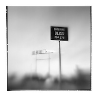USA, Idaho, Bliss, Blurred black and white image of Entering Bliss sign and broken Cafe sign at truck stop