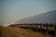 Solar panels for the Solar Park reflecting in the afternoon sun