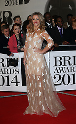 """Kimberley Walsh arriving at the BRIT Awards in London, Wednesday, 19th February 2014. Picture by Stephen Lock / i-Images<br /> File photo - Girls Aloud Star Kimberley Walsh Pregnant. Former Girls Aloud singer Kimberley Walsh has revealed she is expecting her first child with her boyfriend Justin Scott.<br /> <br /> The star told fans the news on Twitter, writing: """"Justin and I are so happy to let you all know we are having a baby!!! Couldn't wait to share our lovely news with you all.<br /> Photo filed Tuesday 25th Feb 2014."""