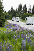 USA, Alaska, row of recreational vehicles on road