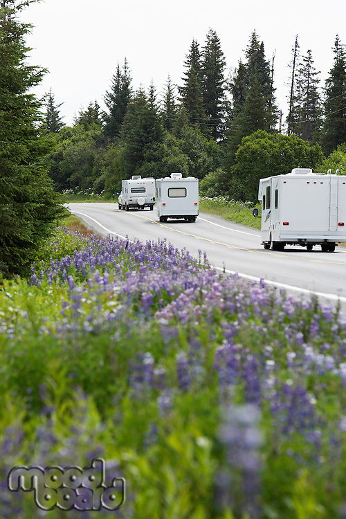 USA, Alaska, row of recreational vehicles on road