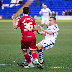 BIRKENHEAD, ENGLAND - Saturday, February 18, 2012: Tranmere Rovers' James Wallace in action against Charlton Athletic's Yann Kermorgant during the Football League One match at Prenton Park. (Pic by Vegard Grott/Propaganda)
