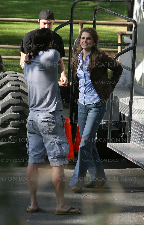 LOS ANGELES, CALIFORNIA - MONDAY 21ST APRIL 2008. NON EXCLUSIVE: Adam Sandler riding a motor cycle with co star Keri Russell for an action scene in their latest movie 'Bedtime Stories.' Later Russell was met by her husband Shane Deary . Photograph: On Location News. Sales: Eric Ford 1/818-613-3955 info@OnLocationNews.com