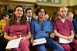 "© Licensed to London News Pictures. 27/11/2019. London, UK. NHS workers hold revealing official government documents showing the US is demanding that the NHS will be ""on the table"" in talks on a post-Brexit trade deal on the National Health Service. Photo credit: Ray Tang/LNP"
