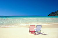 Two beach chairs on an empty beach (Flamenco Beach)