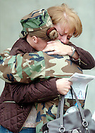 Sgt. Christine McAdow is hugged by her aunt Teresa Rayner after the departure ceremony for the soldiers the Kansas National Guard's 635th RSG (Regional Support Group) in Hutchinson, Kan., Saturday, April 29, 2006. Eighty members of the 635th RSG are being deployed to Iraq for a logistics role. (AP Photo/The Hutchinson News, Travis Morisse)
