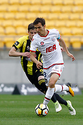Adelaide United's Isaías, right, controls the ball in front of the Phoenix's Alex Rufer in the A-League football match at Westpac Stadium, Wellington, New Zealand, Sunday, October 08, 2017. Credit:SNPA / Dean Pemberton **NO ARCHIVING**