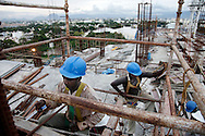 Construction workers at Fun Republic Mall, newly developed shopping mall, in Coimbatore, India on Oct 22, 2010. India's booming economy attracts foreign capital and it is causing the Indian rupee to appreciate.  (Photo by Kuni Takahashi)