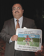 HISD Chief Operating Officer Leo Bobadilla shows off the J. Howard Rambin III Founder's Award on Monday, Oct. 28, 2013, during the Mayor's Proud Partners Luncheon. The award was presented to HISD for its Green Building Initiative.