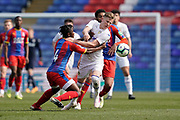 Mateusz Bogusz of Leeds United U23 is tackled during the U23 Professional Development League match between U23 Crystal Palace and Leeds United at Selhurst Park, London, England on 15 April 2019.