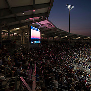 August 30, 2017 - New York, NY : A big screen in the Grandstand displays an image of the sunset over manhattan as the crowd watches Alexander Zverev and Borna Coric, not visible, compete on the third day of the U.S. Open, at the USTA Billie Jean King National Tennis Center in Queens, New York, on Wednesday evening. <br /> CREDIT : Karsten Moran for The New York Times