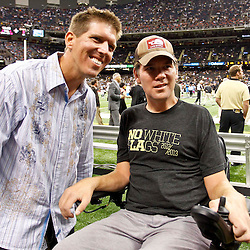October 7, 2012; New Orleans, LA, USA; Joe Unitas son of former NFL quarterback  Johnny Unitas greets former New Orleans Saints defensive back Steve Gleason prior to kickoff of a game against the San Diego Chargers at the Mercedes-Benz Superdome. Mandatory Credit: Derick E. Hingle-US PRESSWIRE