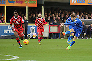 AFC Wimbledon midfielder Jake Reeves (8) shoots on goal during the EFL Sky Bet League 1 match between AFC Wimbledon and Walsall at the Cherry Red Records Stadium, Kingston, England on 25 February 2017. Photo by Matthew Redman.