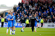 Gillingham FC midfielder Jake Hessenthaler (8) embraces Gillingham FC midfielder Josh Wright (44) as news of the results from other grounds come in confirming their status in League 1 during the EFL Sky Bet League 1 match between Northampton Town and Gillingham at Sixfields Stadium, Northampton, England on 30 April 2017. Photo by Dennis Goodwin.
